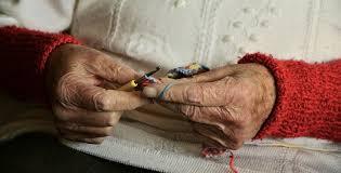 elderly woman's hands knitting