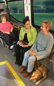 individiuals with disabilities riding a city bus