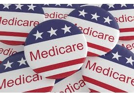 Pile of buttons with stars and stripes that say Medicare