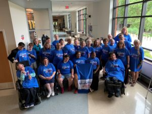 Group of people wearing Wisconsin Disability Vote Coalition t-shirts