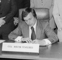 Governor Martin Schreiber signing bill at desk